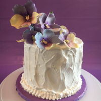 I Love Pansies! Sugar paste pansies. Orange chocolate cake with ganache filling and meringue frosting.