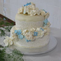 Ivory Roses Wedding Cake I made this cake for my nephew and his new wife. I made and covered both tiers and the sugar flowers at my home home, then It was...