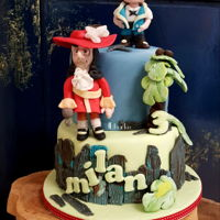 Jake And The Neverland Pirates childs birthday cake.For the first time I made figurines that had to look like the tv series....Worked with Satin.ice fondant and rolkem...