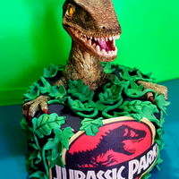 Jurassic Park Cake All edible. Raptor was sculpted using modeling chocoalte. Leaves were dusted using the Petal craft dust set