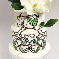 Magnolia Cake For this cake I decided to try the Stained glass effect design to match with the big magnolia on top!Hope you like it!