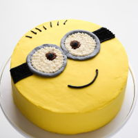 Minion Cake minion cake - chiffon cake filled with freshly whipped cream and fruit cocktail, and decorated with colored whipped cream
