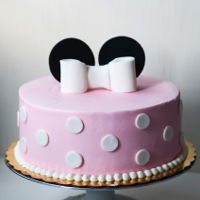 Minnie Mouse Cake minnie mouse cake - strawberries and cream cake covered with cream cheese buttercream and topped with handmade fondant bow and mouse ears