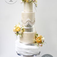 Modern Elegance The cake was designed for the Modern Bride with elegant champagne pearled tiers and silver accent tiers. The tiers are decorated with...