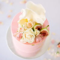 Peach Marble Cake Gorgeous peach marbled fondant cake. Topped with sail and figs