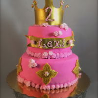 Princess Baby! Gold and pink princess birthday cake! Fondant covered, with sugar paste crown and name ribbon.