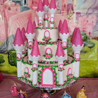 Princess Castle Cake This was a two tier strawberry cake with a Styrofoam dummy cake as the bottom layer. I used two sets of the Wilton Castle Kits to have...