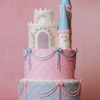 Princess Castle Cake This beautiful castle is featured as the topper on a princess themed cake. Made with mostly buttercream and a bit of fondant. It's...