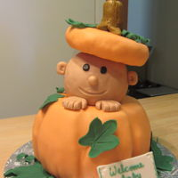 Pumpkin Baby Shower the pumpkin base is cake covered in fondant. The baby head and pumpkin top is rice crispies treat covered in fondant. the stem and leaves...
