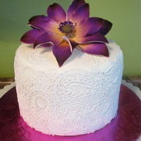 "Purple Flower Premade flower on 6"" cake with paisley cake lace. I had to decorate this quick & didn't wish I had colored fondant but it..."