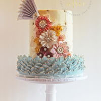 Shabby Chic Vintage Flower Cake This cake was a spin off of my daughters first birthday cake. It was designed for a tutorial featuring fabric flowers. The bottom tier has...