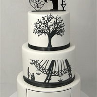 Silhouette Wedding Cake The bride and grooms love story told as a series of black silhouettes on a white background