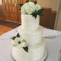 Simple Wedding Cake 3 tier with buttercream, white fresh flowers with greenery
