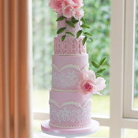 Soft Pink Wedding Cake Soft pink wedding cake with lace and sugar flowers