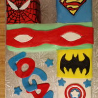 Spiderman, Superman, Ninja Turtles, Batman, Captain America Number 4 cake with Spiderman, Superman, Ninja Turtle, Batman, and Captain America.