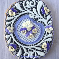 Spring Lace | Sweet Prodigy This is a large sugar cookie. The outer portion is hand-piped royal icing. The grid in the center is SugarVeil edible lace and the pansies...