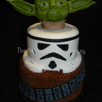 Star Wars - Yoda, Stormtrooper, And Chewbacca Star Wars tiered cake. Chewbacca tier iced in chocolate buttercream. Stormtrooper covered in fondant. Yoda made from modelling chocolate....