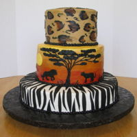 Sunset, Lions, Africa all buttercream except for the fondant stripes