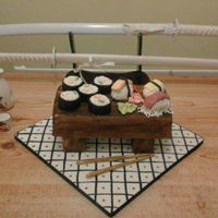 Sushi Cake The table legs are rice krispie treats and the table top madeira sponge. Everything on the table is edible and modelled out of a mixture of...