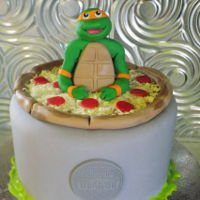 Teenage Mutant Ninja Turtles Red Velvet cake with cream cheese frosting with fondant and gumpaste decorations