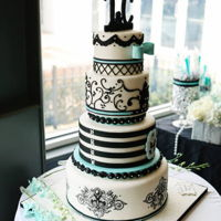 Tiffany Themed Cake Inspired by the classic Breakfast at Tiffany's movie with Audrey Hepburn. Main colors are black and robin's egg blue. Bottom...
