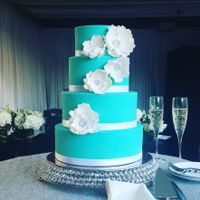 Tiffany Wedding Tiffany blue wedding cake with white fantasy flowers and broach centers