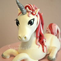 Unicorn Cake Victoria sponge chocoate cake filled with strawberry cream. The unicorn is handmade.