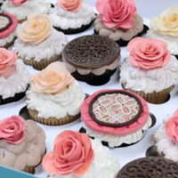 Vintage Cupcakes Rose, mauve, cream and brown cupcakes. Toppers are all made with modeling chocolate and then dusted with colors.