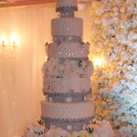 Wedding Cake Beautiful tiers adorned with floral accents, Sequin bands, crystal trimmings and hand pipped accents.