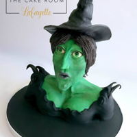"Wicked Witch Of The West This is a 10"" tall sculpted figure of the Wicked Witch made out of modeling chocolate and fondant. I will be teaching this figure at..."