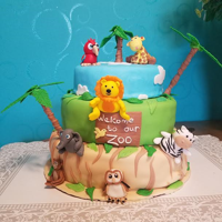 Zoo Cake My first three tier cake! it's made with Red velvet, vanilla frosting and fondant.