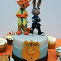 Zootopia Cake Edible toppers made with laped modeling paste. Zootopia themed cake and cupcakes