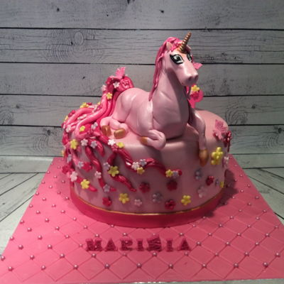 A Unicorn Cake!!! It's a layer cake with Oreo mousse and strawberry chocolate