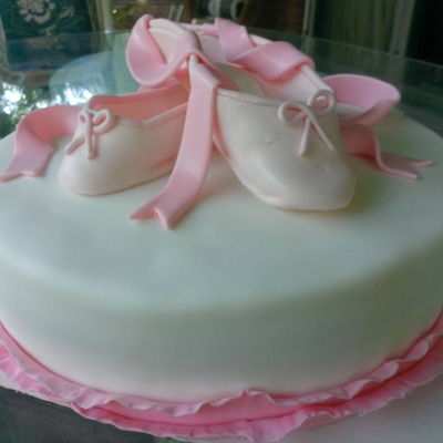 Ballet Slipper Cake Pink ballet slippers on a delicate ruffled layer cake