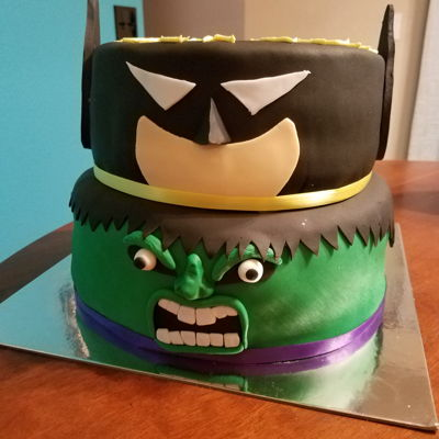 Batman And Hulk This was my first tiered cake. It was done as a donation for Icing Smiles.