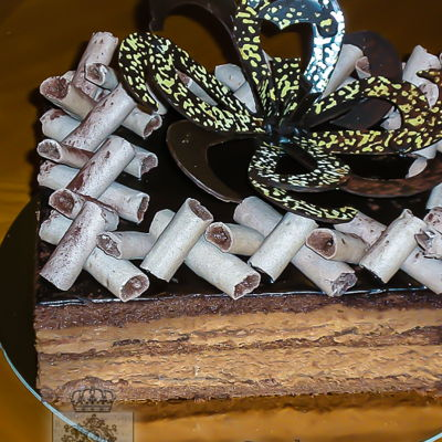 Caraibe Torte European Style torte. Layers of chocolate sponge cake, moistened with Jamaican rum syrup, chocolate buttercream, chocolate ganache....