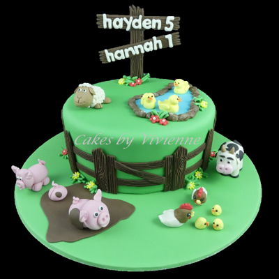 Farm Animal Cake 9 inch chocolate mud cake decorated with all fondant and gumpaste amimals.