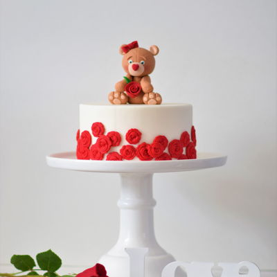 "Teddy Bear Love Cake hand sculpted teddy bear sitting a top an 8"" cake"