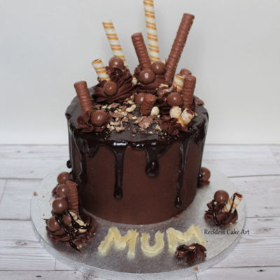Ultimate Chocolate Drip Cake A chocolatey chocolate cake with 3 layers filled with dark chocolate buttercream and dark chocolate ganache. Topped chocolate favourites....