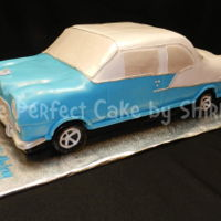 1955 Chevrolet Bel Air Classic Car I modelled this after the actual car. All cake, carved, and covered in fondant.