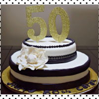 50Th Birthday Cake Black and white marshmallow fondantThe cake/buttercream is also vanillaI used Wilton gum paste for the flowerI am learning to do cakes so I...
