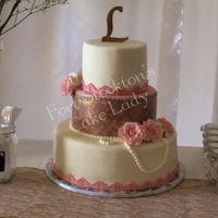 Antique Elegance Vanilla cake, vanilla buttercream with homemade fondant. On the middle tier I used the Evil Cake Genius' gold piping gel with the...