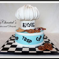 Baking & Cooking Chef Cake RKT chef hat with chocolate chip cookies, pizza, and wooden spoon was created with fondant, gumpaste, chocolate, piping gel, and royal...