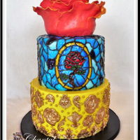 Beauty And The Beast Rose on top is a 6 inch sculpted cake with modeling chocolate petals.