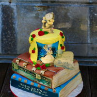 Beauty And The Beast 3 tier cake made with edible images, buttercream, and fondant