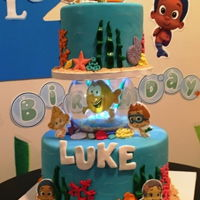 Bubbles Guppies Cake 2nd Birthday cake - 2 tiered cake with fishbowl in the middle, Bubble Guppies edible image characters and under the sea decorations