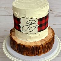 "Buffalo Plaid Cake Vanilla Cake with Italian Meringue rustic buttercream sitting on top of a cake ""log"""
