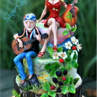 Country Music - Music Around The World 2016 Collaboration The cake is hand painted fondant, the figures of Willie Nelson and Dolly Parton are made of modeling chocolate with a wire armature, the...