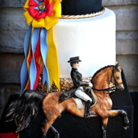 """dressage"" - Sport Cakes For Peace Collaboration This cake is made of styrofoam cake dummies covered in fondant. The horse and rider are painted with edible colors on a fondant cutout. The..."