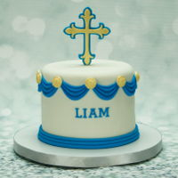 First Communion Cake First communion cake for a friend's son. Six inch round chocolate fudge cake with dark chocolate frosting filling, covered and...